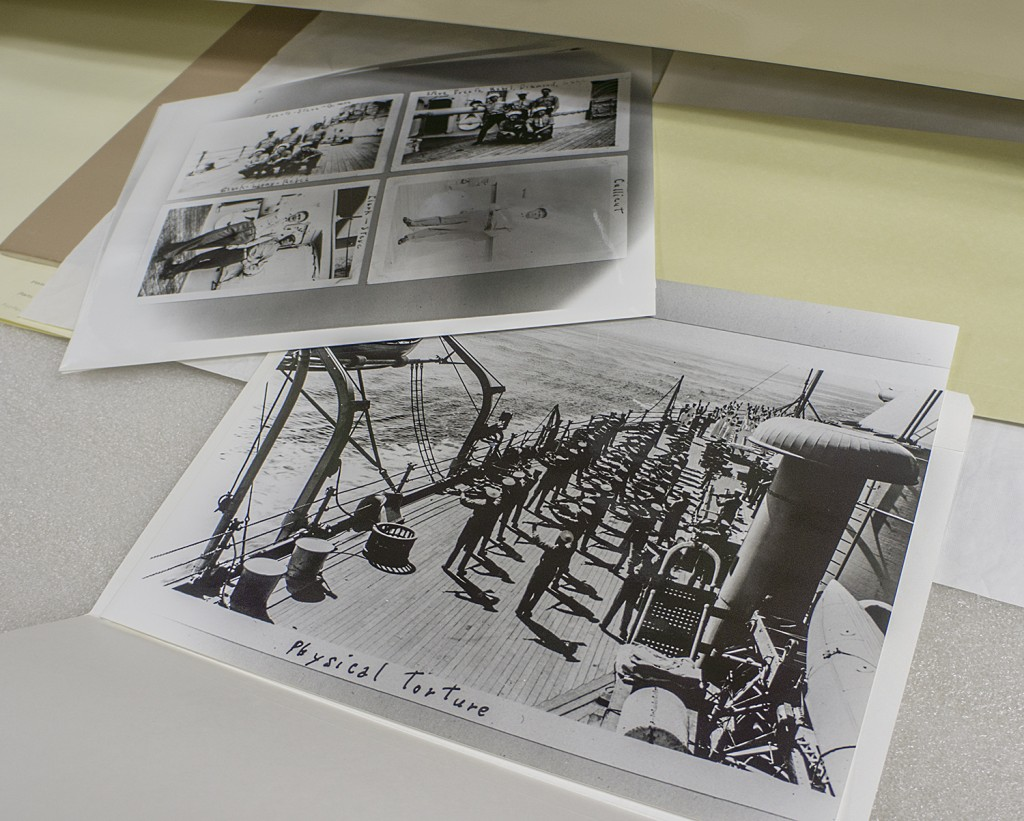 Pages from a sailor's album of life on the naval base. This photograph depicts organized calisthenics on one of the ships.