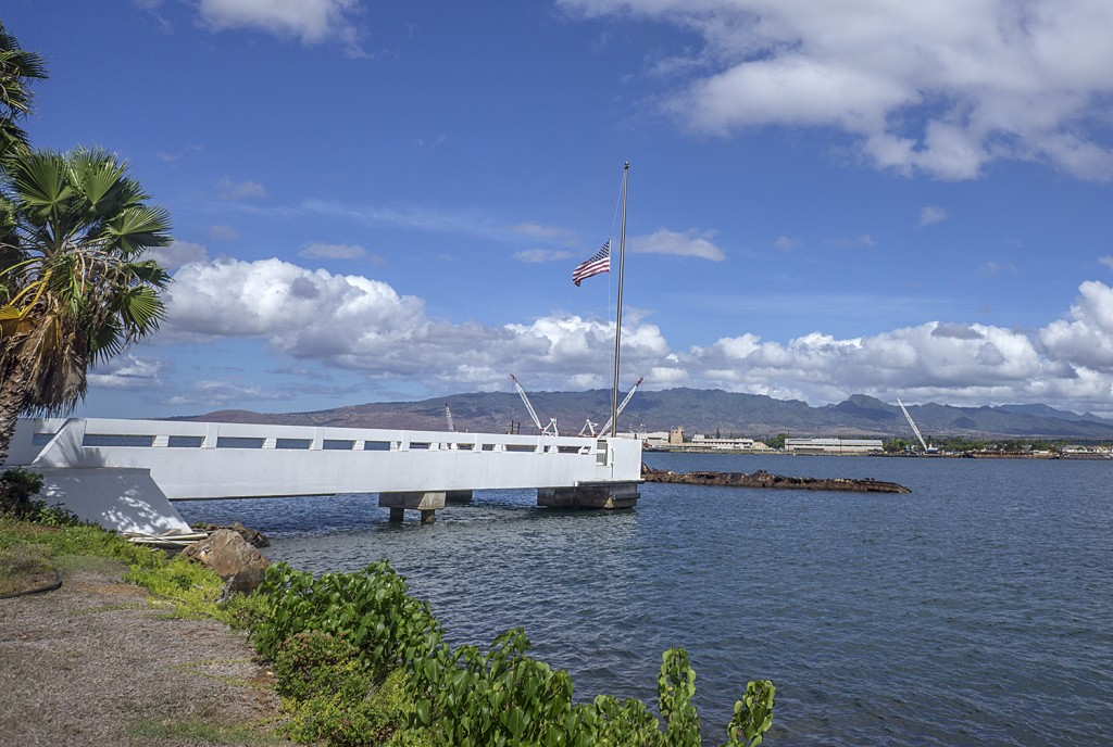 Part of the USS Utah's hull is visible above the surface.