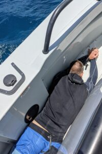 Man laying facedown on a boat