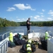 Bob pulling up the anchor on the pontoon